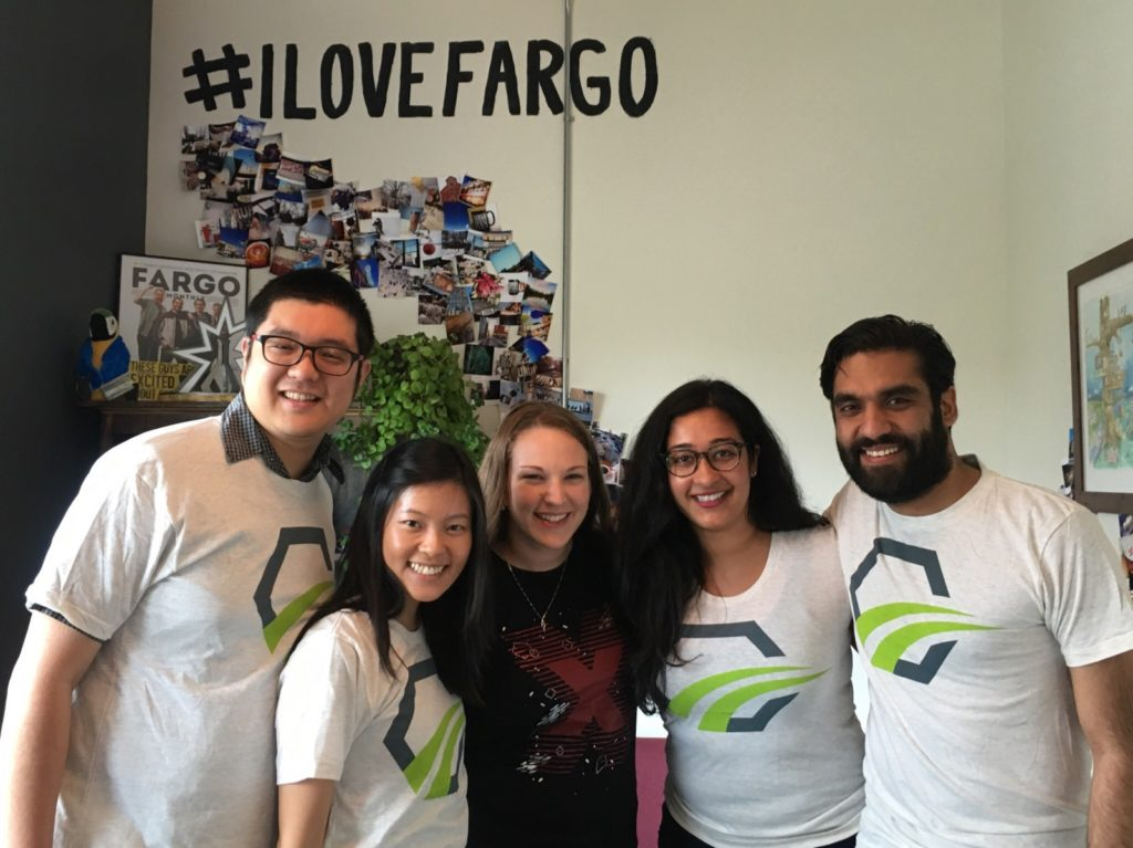 The team with Annie Wood, Program Director at Emerging Prairie, showing some Fargo love!